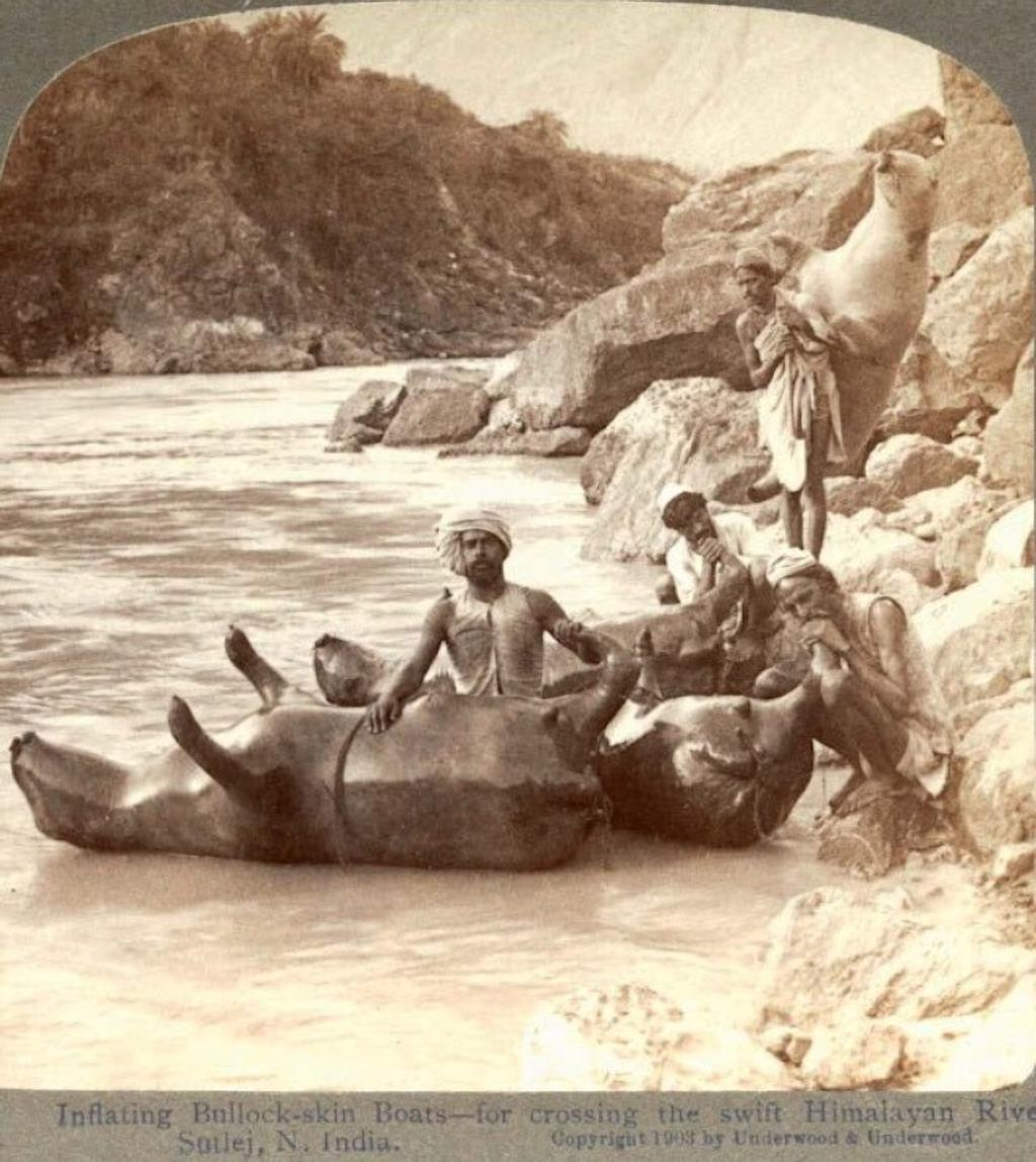 25-inflating-cow-skins-to-use-as-boats-in-the-indian-himalayas-1903