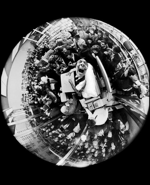 35-salvador-dali-at-a-book-signing-taken-with-a-fisheye-lens-by-philippe-halsman-1963
