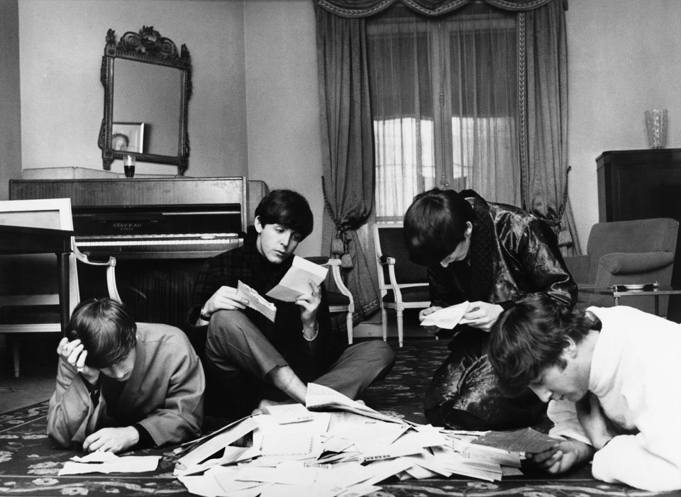 36-the-beatles-reading-fan-mail-1964