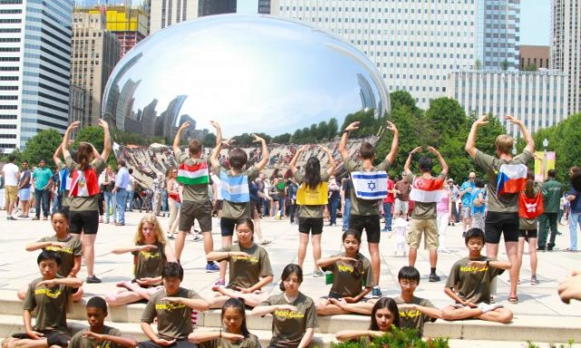 Ride2Freedom cyclists demonstrate the Falun Gong exercises in Chicago