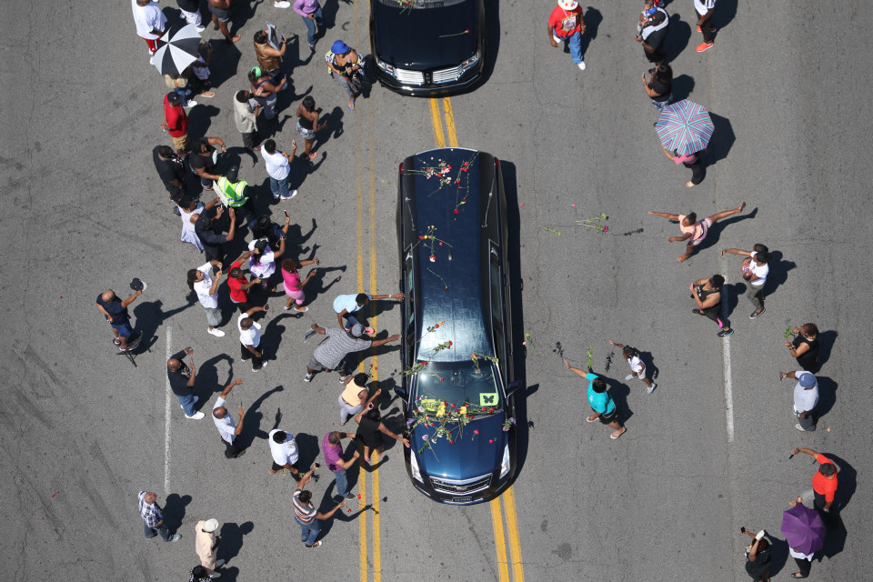 The funeral procession for Muhammad Ali makes its way though Louisville, KY