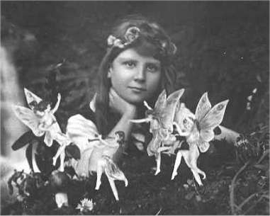The first of the five photographs, taken by Elsie Wright in 1917, shows Frances Griffiths with the alleged fairies. (Public Domain)