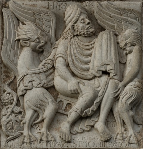 Relief on the Miègeville's gate of the basilica Saint-Sernin in Toulouse, France, as seen on Dec. 15, 2012. The relief shows Simon Magus surrounded by demons. (Pierre Selim/Wikimedia Commons)