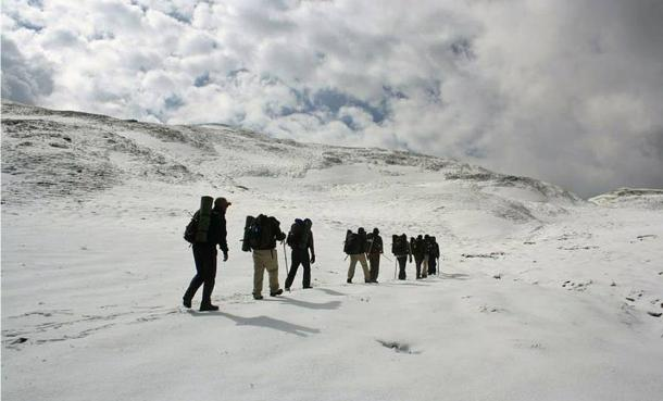 Trekkers making their way to Roopkun in the Himalayas