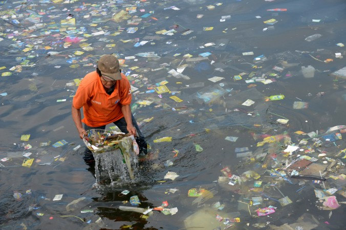 Plastic bags and other rubbish are collected from the waters of Manila Bay, Philippines, on July 3, 2014. (Jay Directo/AFP/Getty Images)