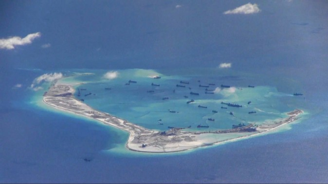 Chinese dredging vessels are in the waters around Mischief Reef in the disputed Spratly Islands in the South China Sea in this still image from video taken by a P-8A Poseidon surveillance aircraft on May 21, 2015. (U.S. Navy)