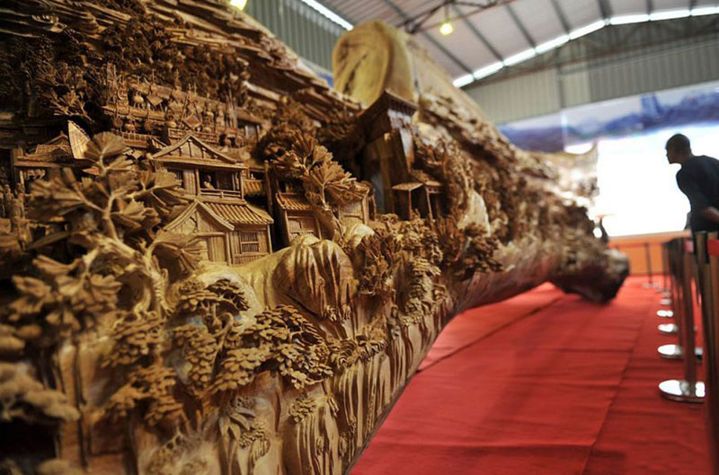 Wood Carver Transformed a 40-feet Tree Trunk into an Intricate Work Of Art.