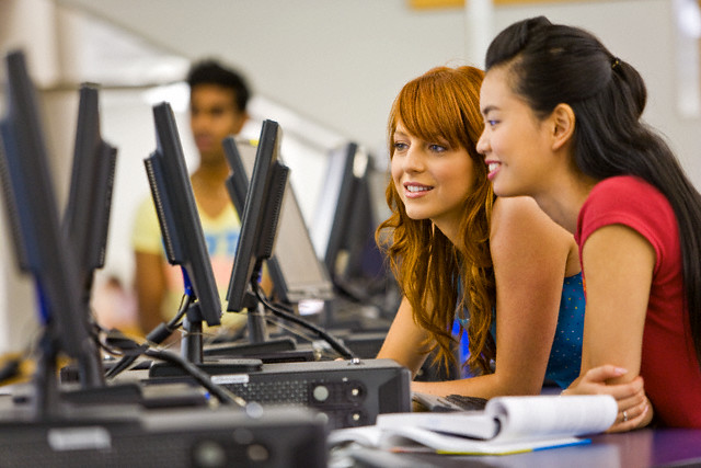 College Students in Computer Lab --- Image by © James Lauritz/Corbis