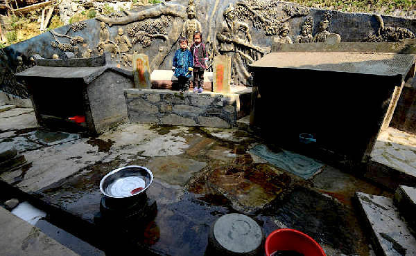 Two wells in the village, one for having boys, the other for having girls. (Image: NTD TV)