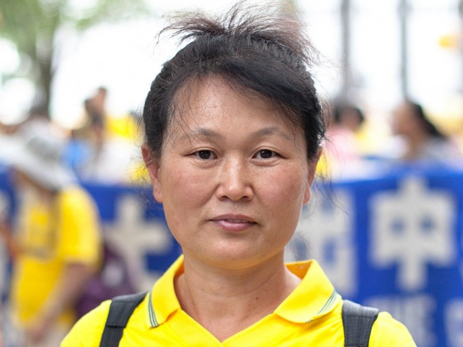 Li Qiong, a practitioner of Falun Gong who fled to the United States to escape persecution earlier this year, poses for a picture at Dag Hammarskjold Plaza in New York City on July 20, 2015. (Larry Ong/Epoch Times)