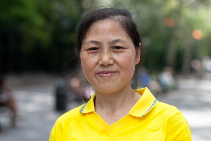 Yu Kun, a practitioner of Falun Gong who was tortured and abused in China's prisons, attends a rally calling for the end of the persecution in Dag Hammarskjold Plaza in New York City on July 20, 2015. (Larry Ong/Epoch Times)