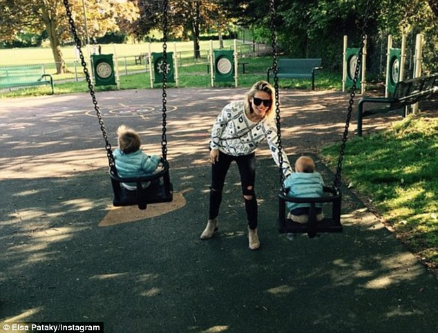 Cute! On Saturday, she spent time at the park with her 14-month-old twin boys, Sasha and Tristan