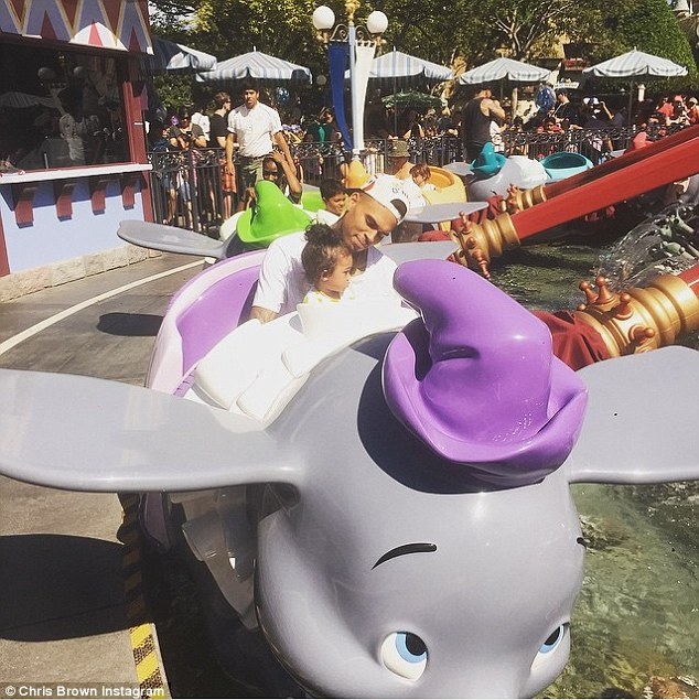 Big trip: Chris Brown continued the birthday celebrations by bringing his daughter Royalty to Disneyland as he shared this picture of them riding theDumbo The Flying Elephant ride on Monday