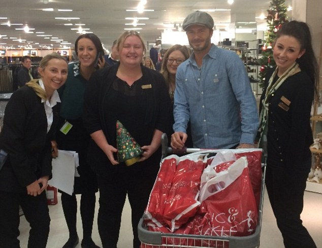 Christmas came early: David Beckham shopped up a storm in the London Colney branch of Marks and Spencer