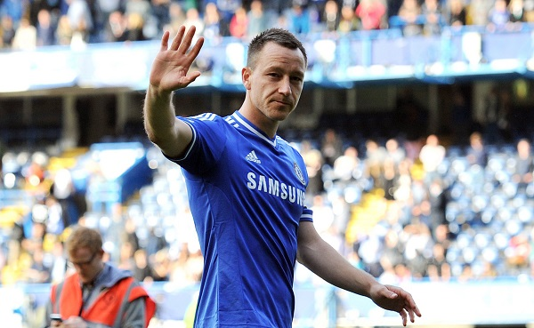Chelsea's English defender John Terry waves to the fans after the English Premier League football match between Chelsea and Norwich City at Stamford Bridge in London on May 4, 2014. Chelsea missed the chance to go top of the Premier League after being held to a goalless draw at home to strugglers Norwich. AFP PHOTO / GLYN KIRK RESTRICTED TO EDITORIAL USE. No use with unauthorized audio, video, data, fixture lists, club/league logos or live services. Online in-match use limited to 45 images, no video emulation. No use in betting, games or single club/league/player publications. (Photo credit should read GLYN KIRK/AFP/Getty Images)