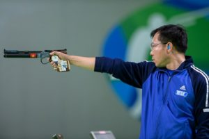RIO DE JANEIRO - AUGUST 6: Gold medalist HOANG Xuan Vinh of Vietnam competes in the 10m Air Pistol Men Finals at the Olympic Shooting Center during Day 1 of the XXXI Olympic Games on August 6, 2016 in Rio de Janeiro, Brazil. (Photo by Nicolo Zangirolami)