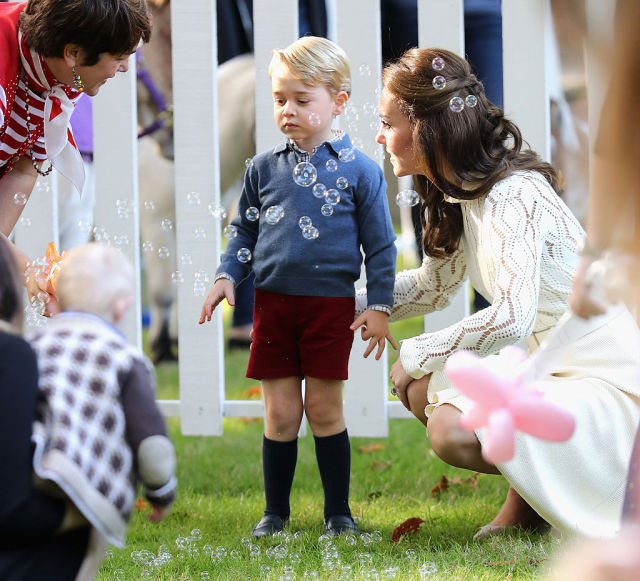 VICTORIA, BC - SEPTEMBER 29: Catherine, Duchess of Cambridge and Prince George of Cambridge at a children's party for Military families during the Royal Tour of Canada on September 29, 2016 in Victoria, Canada. Prince William, Duke of Cambridge, Catherine, Duchess of Cambridge, Prince George and Princess Charlotte are visiting Canada as part of an eight day visit to the country taking in areas such as Bella Bella, Whitehorse and Kelowna (Photo by Chris Jackson - Pool/Getty Images)