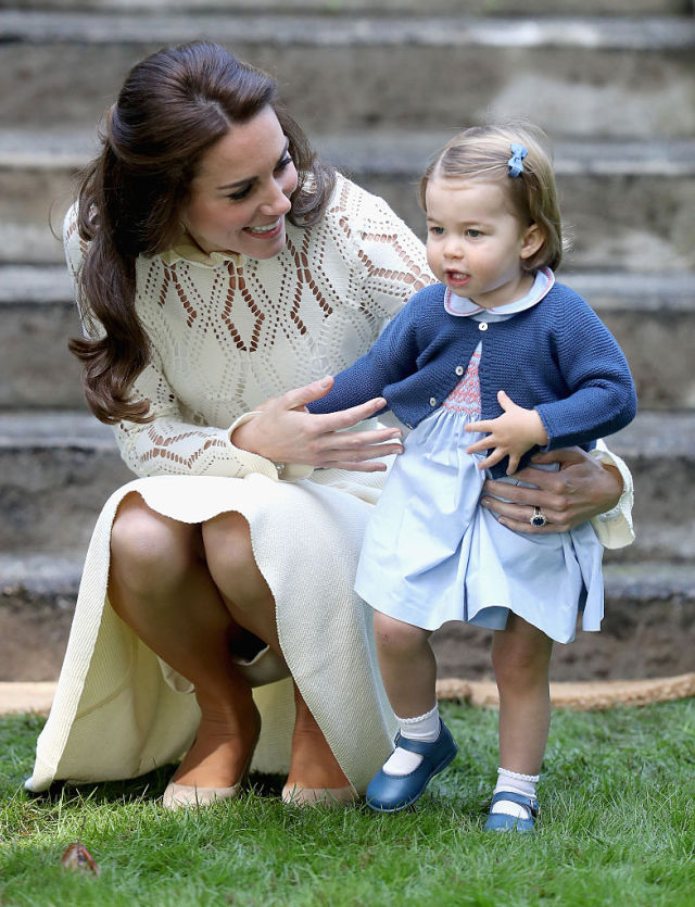 VICTORIA, BC - SEPTEMBER 29: Catherine, Duchess of Cambridge and Princess Charlotte of Cambridge at a children's party for Military families during the Royal Tour of Canada on September 29, 2016 in Victoria, Canada. Prince William, Duke of Cambridge, Catherine, Duchess of Cambridge, Prince George and Princess Charlotte are visiting Canada as part of an eight day visit to the country taking in areas such as Bella Bella, Whitehorse and Kelowna (Photo by Chris Jackson - Pool/Getty Images)