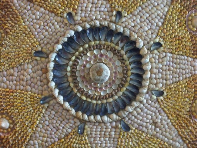Most of the shells are arranged in elaborate designs like the one below.
